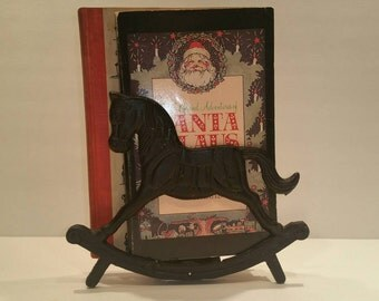 Vintage Christmas books with vintage cast iron book holder