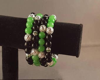 Classy, black and green beaded memory wire bracelet
