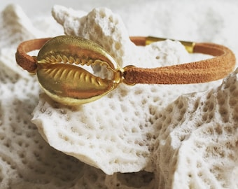 Golden Cowrie Sea Shell bracelet on Suede