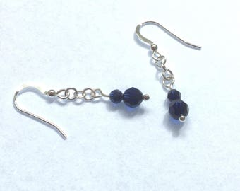 Sterling silver earrings with indigo coloured Swarovski crystals