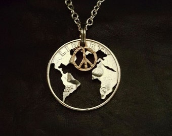 Peace on earth coin jewelry pendant cut from a quarter with a peace symbol cut from a penny