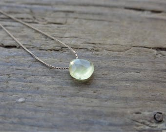 Prehnite necklace. Minimalist necklace with a small faceted prehnite briolette. Minimalist choker with a small faceted prehnite briolette.