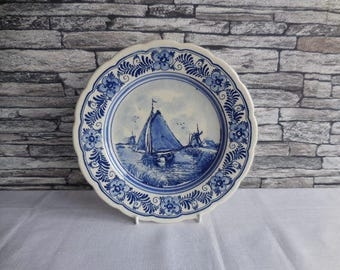 An old blue and white plate by Delft