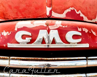 GMC Nose Badge Emblem on Red Truck Photograph