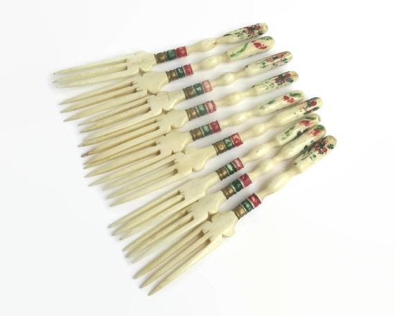 9 antique bone cocktail forks, hand carved, hand painted pattern in green, red, and gold paints, made in Rajasthan, India, 1920s