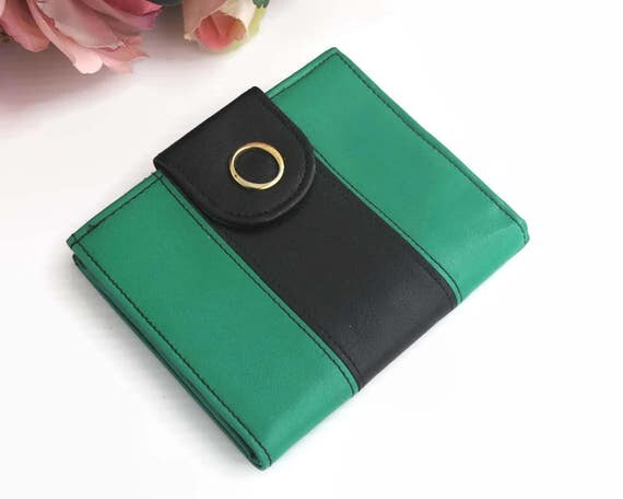 Oroton leather ladies wallet, green and black with black stitching, coin purse, folding money section, gold frame, England, 1970s