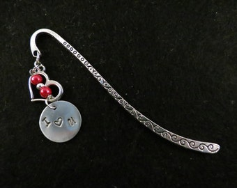 Hand stamped bookmark with heart and beads.