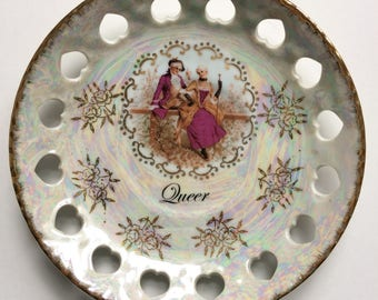 Queer: upcycled, altered, decorative, repurposed vintage Japanese plate with ultra feminine folk dressed to the nines in pink and gold