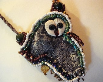 chain,necklace, with great owl, leatherbound, pearls, beads, embroidered