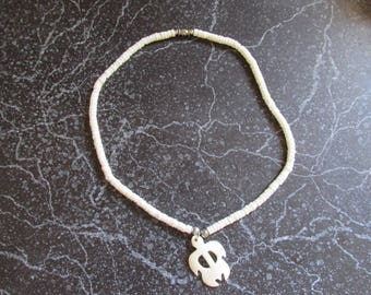 White Pucca Shell Necklace With Attached Charm
