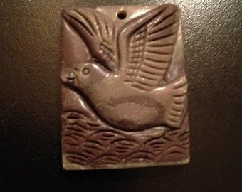 Carved Stone Pendant of a Seagull Over Waves