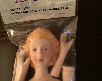 "Vintage 1993 Mangelsen's ""Small Porcelain Doll Head/ Hands & Legs"": Unopened"