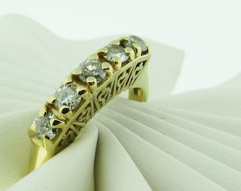 Vintage 14 K gold and diamond wedding band.
