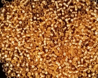 10 Grams of Miyuki Japanese Seed Beads Size 11/0 Amber with Silver Core