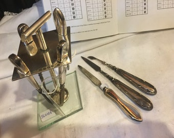 Selection of silver backed manicure tools