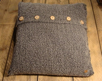 Soft grey cushion with birch wooden buttons.