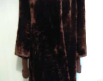 Elegant long fur coat of fur Mouton.  fur coat 3/4 sleeve long fur coat Mouton