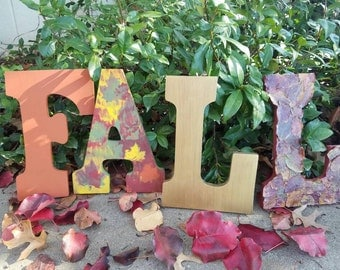 On Sale! FALL letters ready to hang. Real fall leaves preserved on the L. Burnt orange, Red, Yellow, Green, Gold. FALL decor