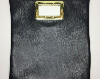 vintage little black vinyl purse with gold tone handle