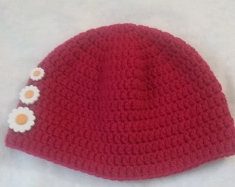 Red beanie hat adorned with three white flower buttons for toddlers three to six years old