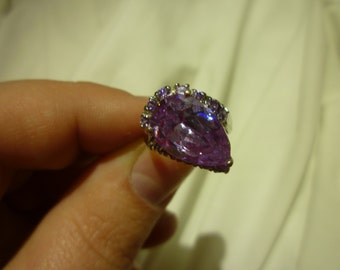 B67 Silver Toned Purple Teardrop Stone Ring Surrounded by 13 Purple Stones, Size 5 3/4.