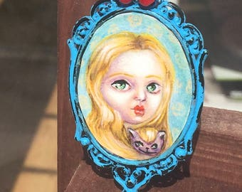 Miniature painting of Alice in wonderland andcheshire cat Wearable unique art. Fantasy, pop surrealism, fairytale.  Acrylic painting.