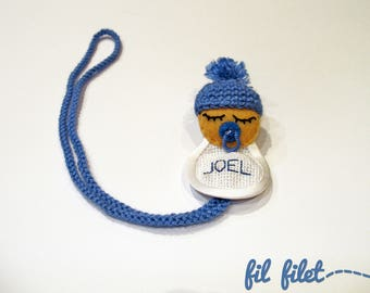 Crochet pacifier holder with custom name and sleeping baby