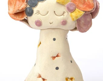 Ceramic little lady with dot bow dress
