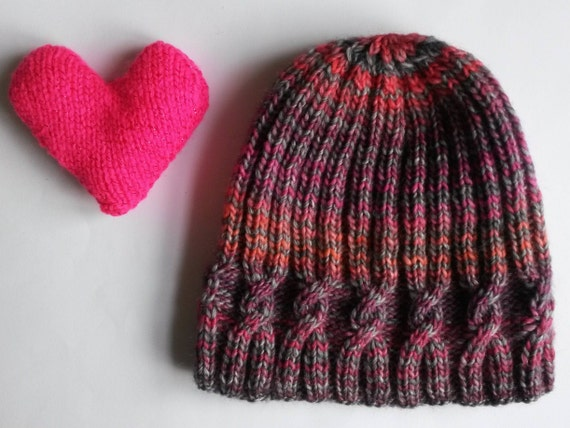 Knit beanie hat: original design with small cable and ribbing. Pink orange grey wool/mix stripe yarn. Made in Ireland. Handknit woman's hat.