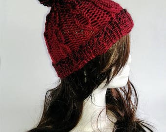 Red cable knitted hat with pom-pom