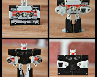 Transformers cassette 1986, Transformers figurine, Transformers 1986, Black audio tape Transformers, 80s toys, Hasbros toys, takara toys