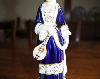 A Beautiful Royal Dux Bohemia Female Musician Figurine.