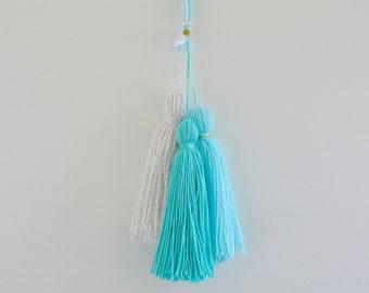 Yarn tassels wall hanging // party decorations // nursery decor // girls room decor // tiffany blue // retail display // party decorations
