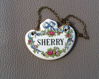 Fine bone china Sherry  tag with brass chain,  dated between 1930 and 1962 by made by Crown, Staffordshire,England