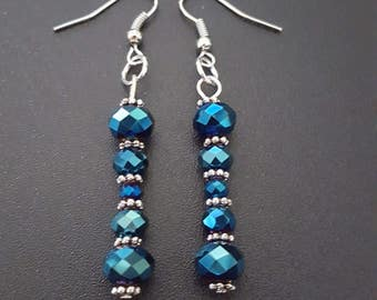 Metallic blue faceted beaded dangle earrings with silver detail
