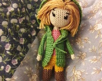Green knitted doll
