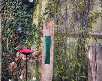 handmade garden sculpture with rectangle of coloured glass