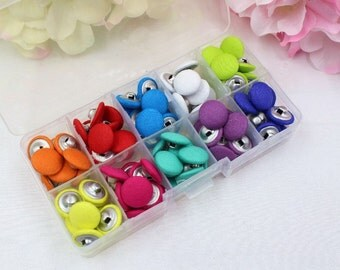 Solid colour fabric wrapped flat back buttons