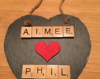 Slate heart personalised with names and hung with jute string. Ideal valentines gift for a loved one