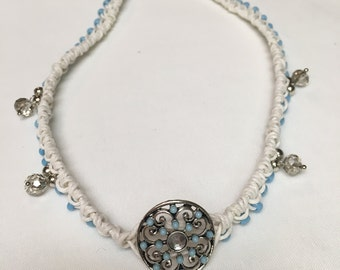 white knotted hemp cord with baby blue glass beads and metal pendant