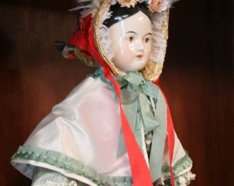 Reproduction 1860's Doll Bonnet with multi colored plaid silk and red ties
