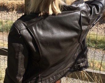 Vintage leather motorcycle jacket with Serval Zippers, side adjusters, chain zipper pulls 1960's