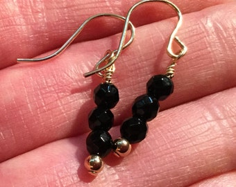 Black Onyx and gold earring