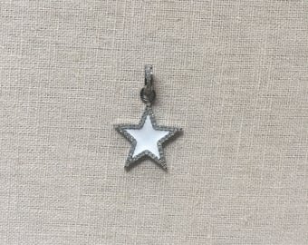 Small white enamel star with single trim of pave diamonds