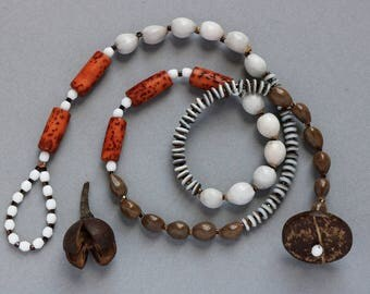 short beaded necklace with natural seeds and nut beads - ethnic statement jewelry - boho style