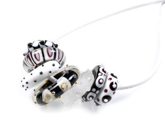 ANO necklace -  Black and white lampwork glass rings on white leather cord