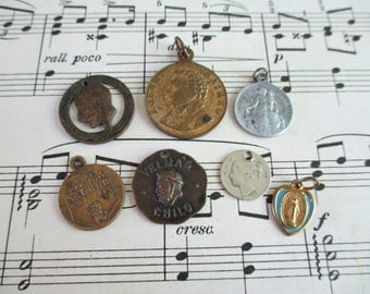 Seven Vintage Assorted Tokens, Pendants and Medallions