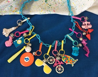 Vintage Ultimate 80's Plastic Bell Clip Toy Charm Necklace Jewelry with Sunglasses, Bike, Map, Camera, Strawberries, Teddy Bear and More