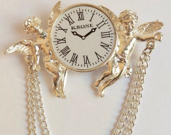 1980s vintage silvertone cupid clock brooch, kitsch baroque style