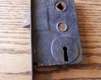 one (1) antique french door lock, vintage original.